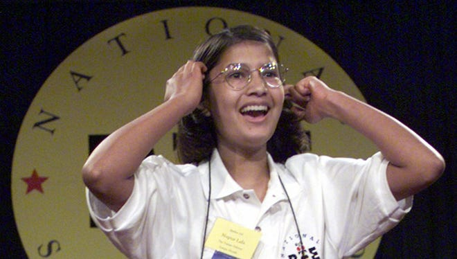 Nupur Lala, 14, of Tampa reacts after winning the 72nd annual National Spelling Bee in Washington in 1999.