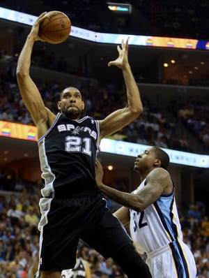 Spurs forward Tim Duncan grabs a rebound in front of Grizzlies forward Ed Davis during Game 3 of the Western Conference finals.