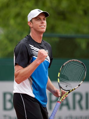 Sam Querrey fires a fist pump during his victory against Lukas Lacko of Slovakia at the French Open on Sunday May 26, 2013.