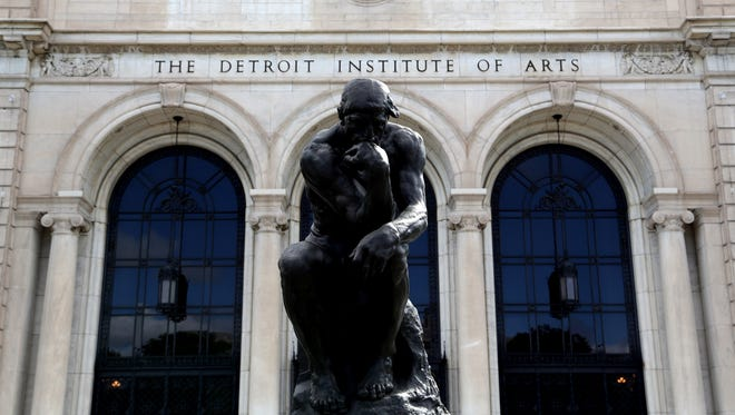 """""""The Thinker"""" by Rodin in front of the Detroit Institute of Arts on Friday, May 24, 2013. The DIA with its millions of dollars of artwork was mentioned by Detroit emergency financial manager Kevin Orr as a potential target to help offset the cost of the city's budget crisis."""