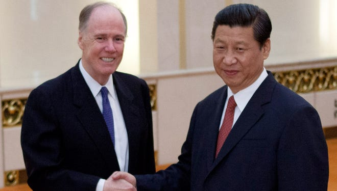 U.S. national security adviser Tom Donilon and Chinese President Xi Jinping shake hands before their meeting at the Great Hall of the People in Beijing on Monday.