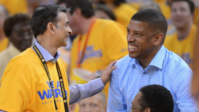 New majority owner Vivek Ranadive and Mayor Kevin Johnson teamed up to keep the Kings in Sacramento.