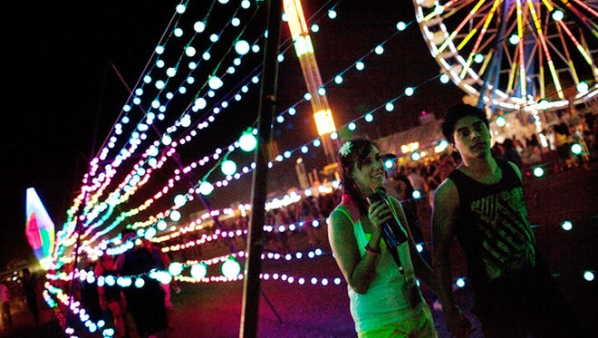 A couple passes by a string of lights on June 24, 2011, in Las Vegas, at the Electric Daisy Carnival.