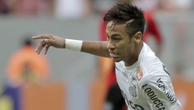Santos' Neymar runs with the ball during a Brazilian soccer championship match against Flamengo in Brasilia, Brazil.