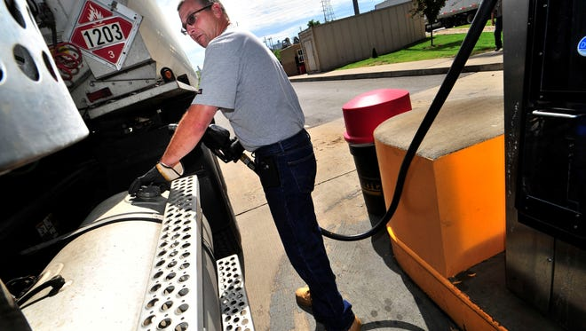 Tim Osborne of White House, Tenn. fills up at a Pilot Flying J Travel Center in Nashville on Wednesday, May 22, 2013.