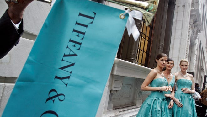 A trio of models wearing Tiffany jewelry and signature Tiffany , Co. blue dresses at Tiffany's Wall Street store. (AP Photo/Richard Drew)