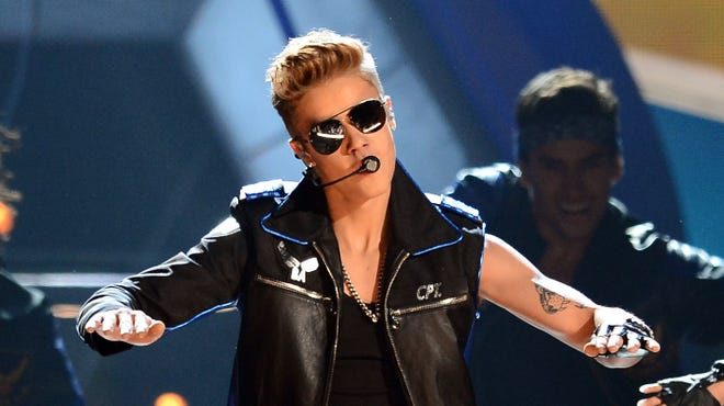 """Justin Bieber performs onstage during the 2013 Billboard Music Awards on May 19. Bieber reached 40M Twitter followers Tuesday and teased his new single """"Heartbreaker."""""""