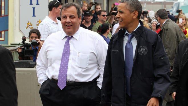 New Jersey Gov. Chris Christie walks the Point Pleasant Beach, N.J., boardwalk with President Barack Obama Tuesday, May 28, 2013.
