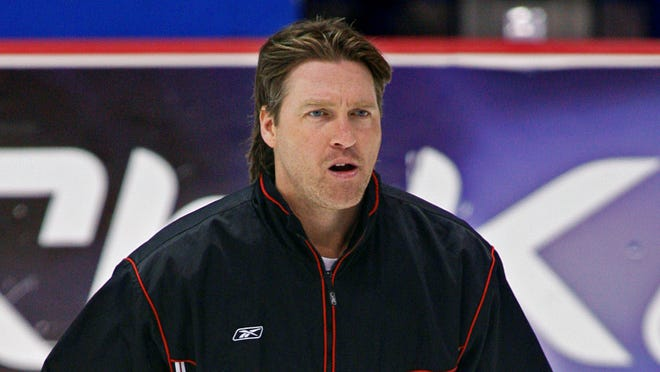 The Colorado Avalanche announced Thursday, that they hired Patrick Roy, shown in this 2006, file photo, as their new head coach.