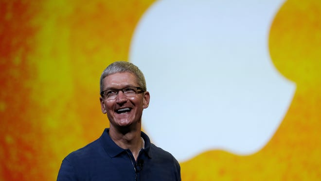 Apple CEO Tim Cook speaks during an Apple event.