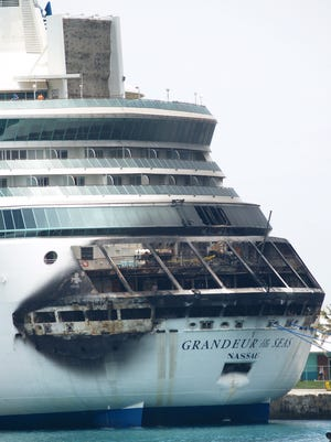 The fire-damaged exterior of Royal Caribbean's Grandeur of the Seas cruise ship is seen while docked in Freeport, Grand Bahama island, on May 27.
