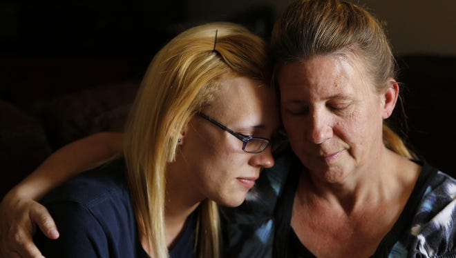 Robin Knott of Bromley, Ky., holds her daughter Candice Williamson, 19, in their home on Tuesday, May 21, 2013.  Until Knott learned of Casey's Law, which allows family members of drug-addicted adult children to use the courts to mandate treatment, Knott believed there was nothing she could do to help her daughter since she was over 18.