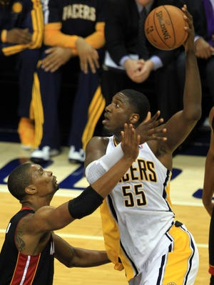 Roy Hibbert scored 23 points and grabbed 12 rebounds in the Indiana Pacers' 99-92 win over the Miami Heat on Tuesday.