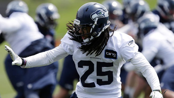 Seattle Seahawks' Richard Sherman (25) in action at an OTA workout in Renton, Wash. Sherman was suspended last year for illegally using Adderall before winning an appeal on a technicality.