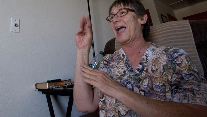 Peggy Sierra talks in American Sign Language with her husband, George Sierra, via a video phone in their apartment at Apache ASL Trails in Tempe, Ariz.