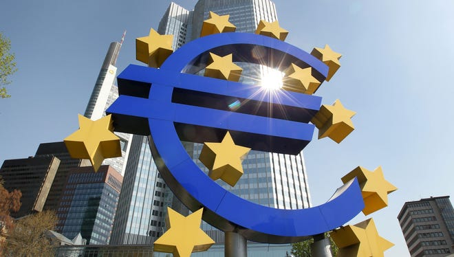 The logo of the European currency Euro standing in front of the European Central Bank (ECB). AFP PHOTO / DANIEL ROLAND