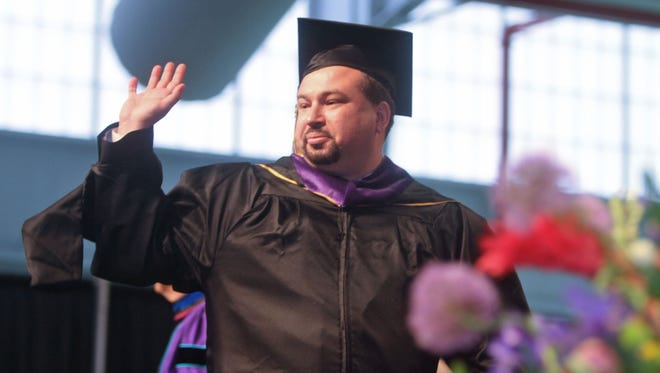 Jeffrey Deskovic waves after receiving his master's degree during graduation ceremonies for the John Jay College of Criminal Justice at the Javitz Convention Center in Manhattan on May 28, 2013.