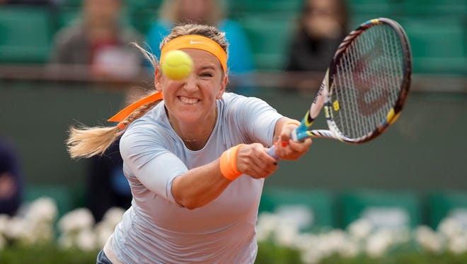 Victoria Azarenka of Belarus lines up a backhand during her 6-1, 6-4 victory Wednesday against Elena Vesnina of Russia.