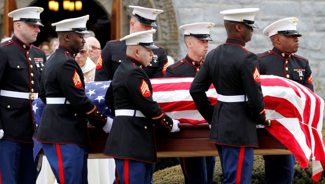 Marines carry the coffin of Lance Cpl. Roger Muchnick Jr., one of seven Marines killed on March 18 when a mortar shell exploded in its firing tube during a training exercise.