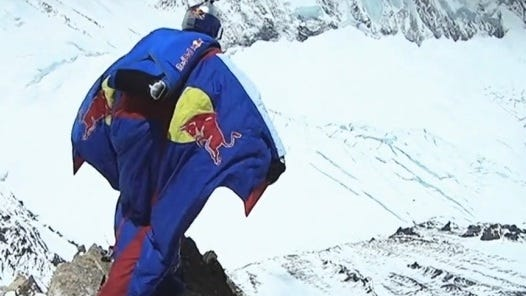 Russian daredevil Valery Rozov leaps from the north side of Mt. Everest at 7,220 meters above sea level May 5  to claim a world record for world's highest BASE jump.