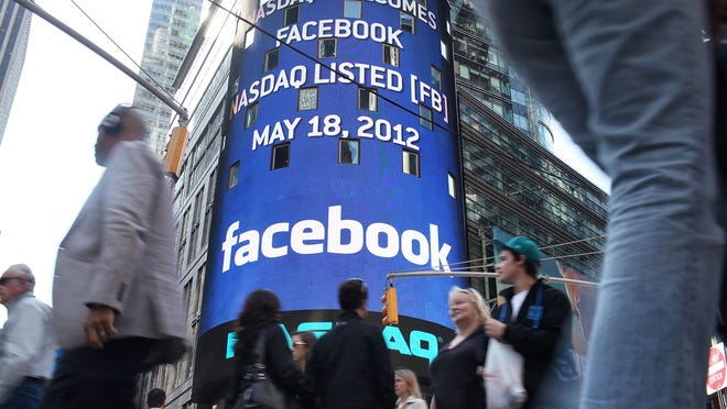 The Nasdaq board in Times Square shows Facebook on May 18.