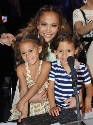 Jennifer Lopez poses with her twins Emme, left and Max in 2012.