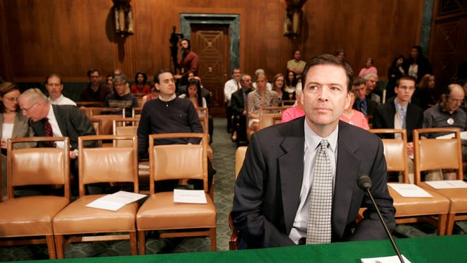 Former deputy attorney general James Comey waits to testify on Capitol Hill on May 15, 2007, before the Senate Judiciary Committee.