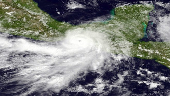 A satellite image shows Hurricane Barbara making landfall on the southern Mexican coast on Wednesday afternoon.