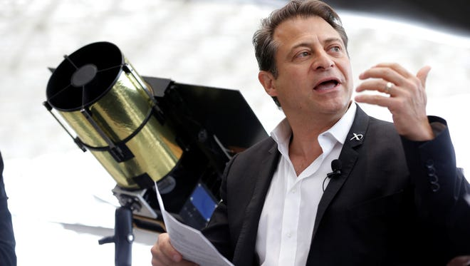 Peter Diamandis, co-chairman of Planetary Resources, an astroid mining company based in Bellevue, Wash., talks to reporters Wednesday, May 29, 2013, in Seattle about his company's plans for the world's first crowd funded space telescope.