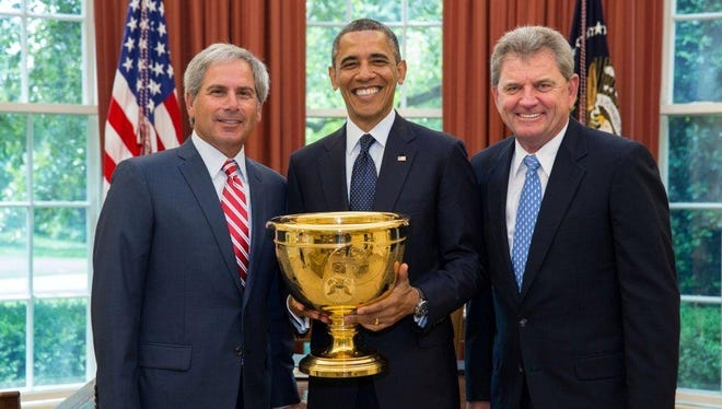 President Obama with Presidents Cup captains Fred Couples of the USA, left, and Nick Price for the Internationals. Obama serves as the honorary of the biennial matches.