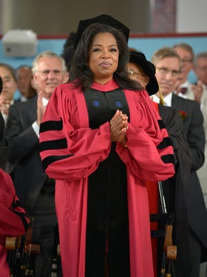 Oprah Winfrey receives an Honorary Doctor of Laws Degree at Harvard's commencement exercises Thursday.