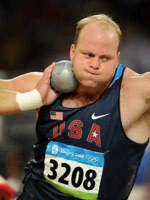 In a photo from the 2008 Beijing Games, Adam Nelson competes in the men's shot put at National Stadium.