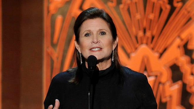 Carrie Fisher attends the AFI Life Achievement Award Honoring Shirley MacLaine at Sony Studios in Culver City, Calif., on June 7, 2012.