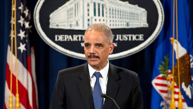 Attorney General Eric Holder speaks May 14, 2013, during a news conference at the Justice Department in Washington.