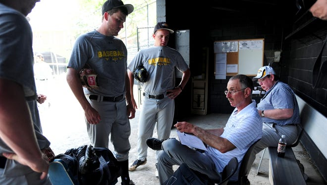 Towson baseball coach Mike Gottlieb (right) talks to players after practice at John B. Schuerholz Park this week as the team prepared for NCAA tournament regional play.