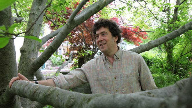 "David Rothenberg talks about cicadas outside his Cold Spring, N.Y., home on May, 15, 2013. A philosopher and accomplished musician, Rothenberg has a new book and CD out called ""Bug Music"" where he writes about and performs music with 17-year cicadas."