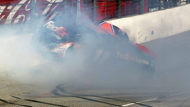 Denny Hamlin hits the wall after colliding with Joey Logano (not pictured) on the final lap of the Auto Club 400 at Fontana, Calif., on March 24.