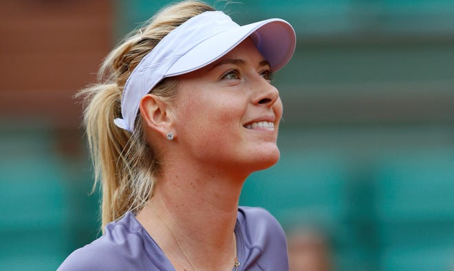 Maria Sharapova of Russia is all smiles after defeating Eugenie Bouchard of Canada 6-2, 6-4.