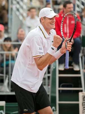 John Isner of the USA celebrates after defeating compatriot Ryan Harrison in five sets.