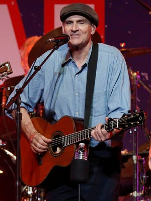James Taylor performs at the Boston Strong Concert at the TD Garden on Thursday.