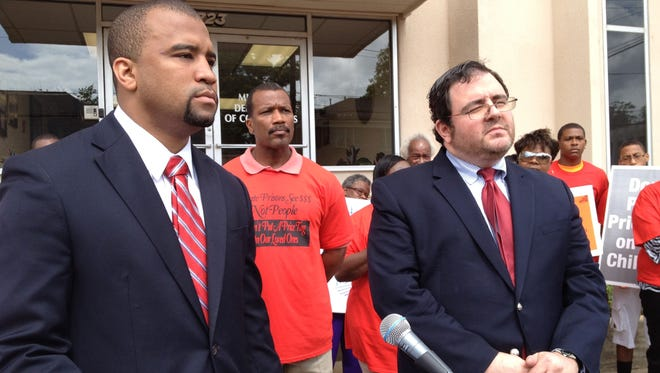 Jody Owens, left, executive director of the Southern Poverty Law Center's Mississippi office, stands Thursday with Gabriel B. Eber, staff counsel for the ACLU's National Prison Project, in Jackson, Miss., to announce a federal lawsuit against the Mississippi Department of Corrections and abuses at the East Mississippi Correctional Facility near Meridian, Miss.