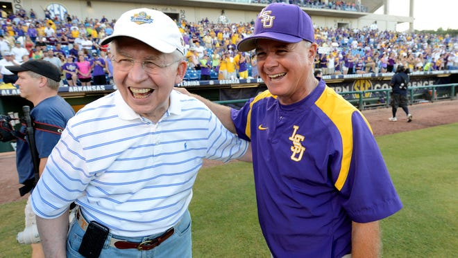 Southeastern Conference Commissioner Mike Slive greets LSU baseball coach Paul Mainieri after the Tigers defeated Vanderbilt for the SEC baseball championship May 26. Slive announced record revenue for the conference at the league's annual spring meetings Friday.