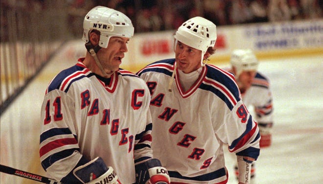 Mark Messier, left, and Wayne Gretzky, right,  are interested in being the next Rangers  coach, according to a Sportsnet report.