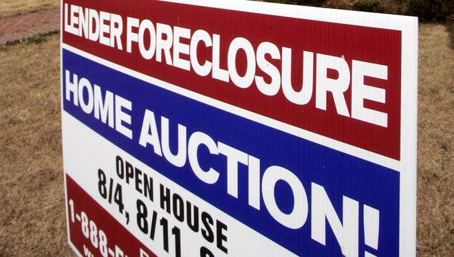A home is advertised for sale at a foreclosure auction in Pasadena, Calif., in 2007.