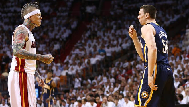 Chris Andersen, left, of the Heat and Tyler Hansbrough  of the  Pacers yell at each other during Game 5.