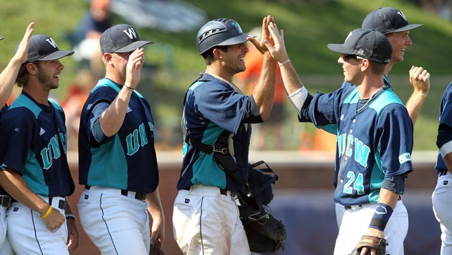 UNC Wilmington players celebrate the 9-5 win over Army in an NCAA college baseball tournament regional game in Charlottesville, Va., Saturday, June 2, 2013.