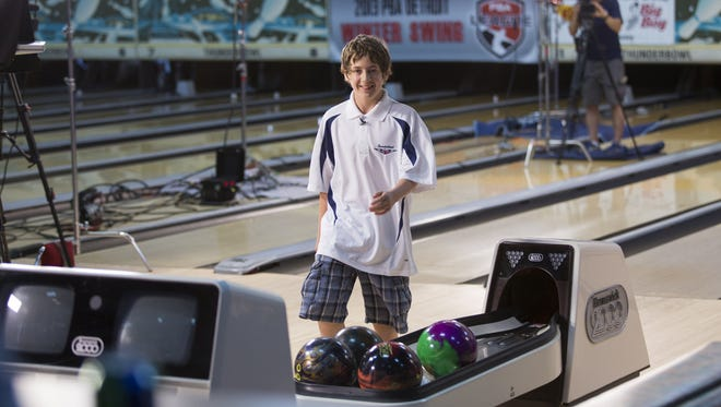 """Gabe Cassise, 12, of Lincoln Park smiles after rolling his first strike during a special taping of """"The All New Bowling For Dollars"""" television show on Saturday, June 1, 2013 at Thunderbowl Lanes in Allen Park, Mich."""