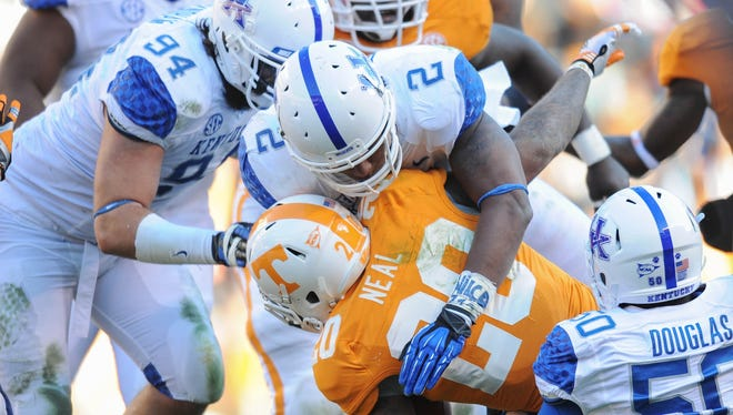 Kentucky's offense and defense have adopted a new mentality under first-year coach Mark Stoops.