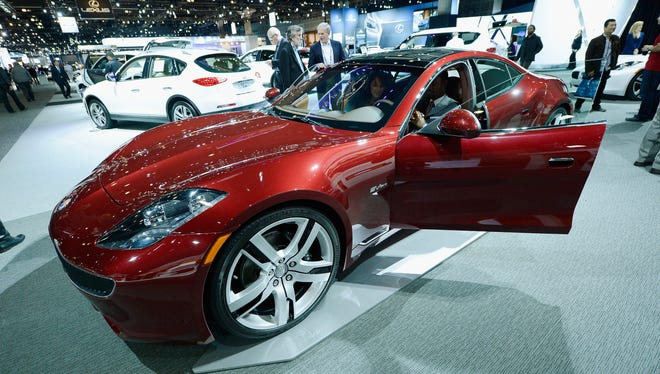 The gas-electric hybrid Fisker Karma at an auto show in Los Angeles last year.