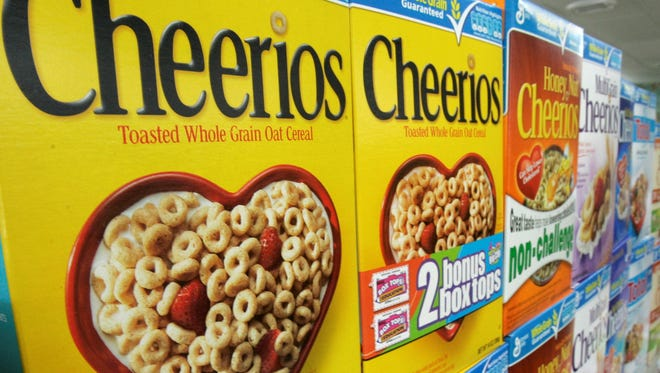 Boxes of General Mills Cheerios breakfast cereal varieties displayed at a Little Rock grocery store.